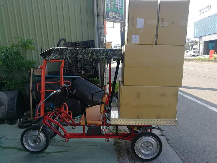 Cargo loaded on electric ligh lorry.